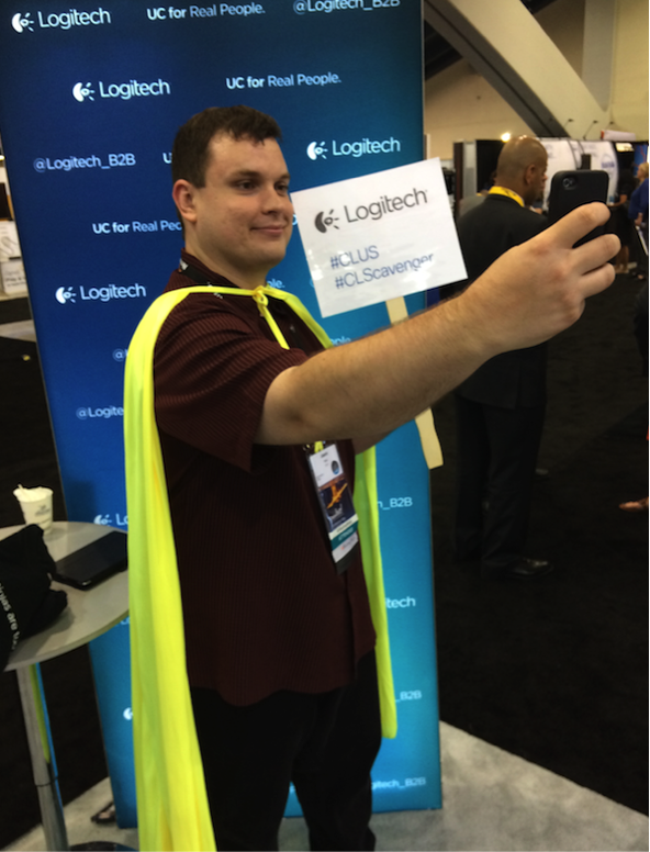 A Cisco Live superhero takes a selfie at the Logitech booth!